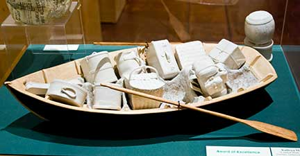 sculpture: rowboat with porcelain inserts