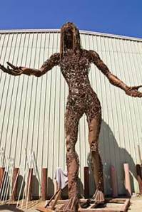 giant sculpture of standing female