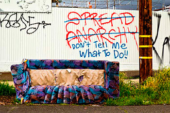 abandoned couch and graffitti