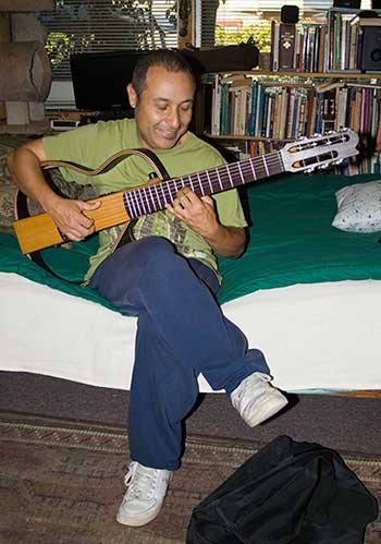 Carlos Oliveira with his guitar