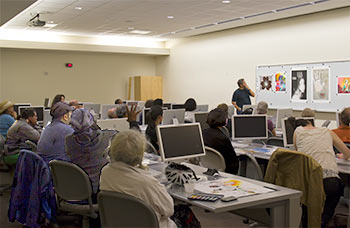 Instructor Matthew Silverberg leads discussion in a Digital Printmaking class.