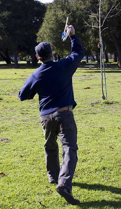 The Wild Card throwing his atlatl in the DeFremerey Park.