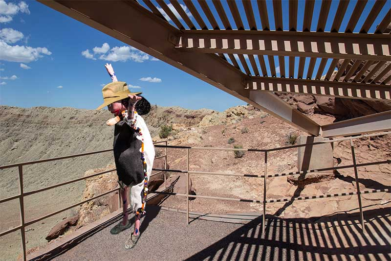 Oola looks down into the meteor crater