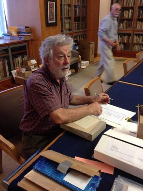 John checks lists.