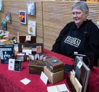 Pat Chupa with some of her books