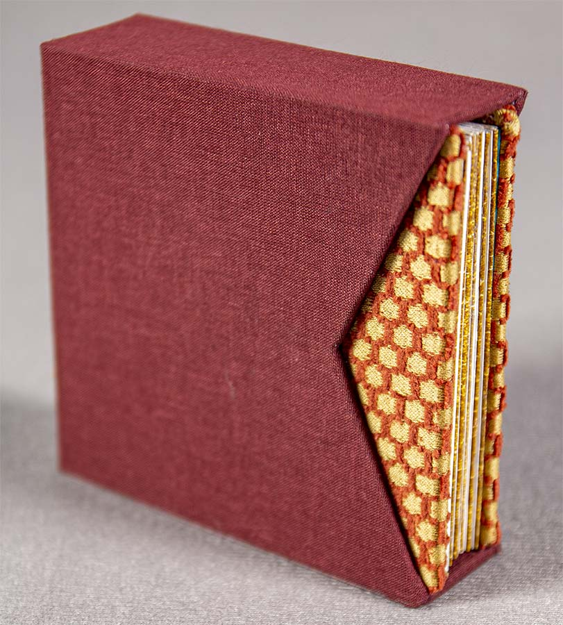 Goldleaf in slip cover